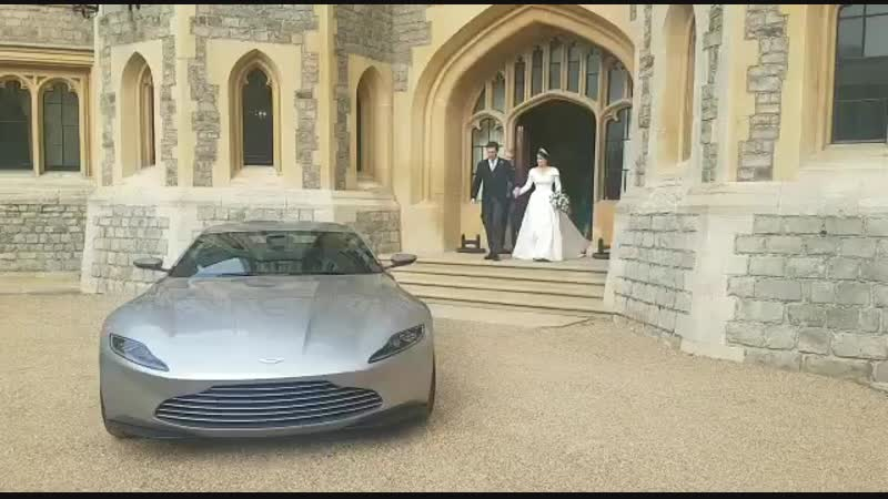 The newly married couple Princess Eugenie and Jack Brooksbank depart from their afternoon reception They left in an Aston Mar