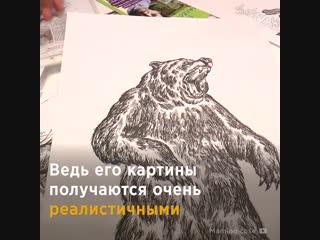 Мальчик рисует животных по памяти