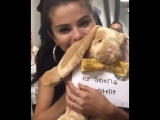 Selena with present