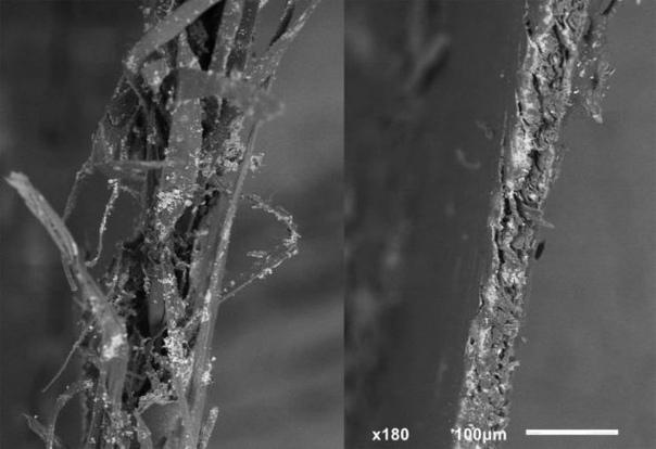 Оторванная и отрезанная ножницами бумага под электронным микроскопом