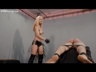Hot cruel blonde nude mistress caning her slave on the caning bench