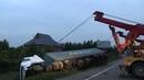 Грузовой эвакуатор, Постановка на колеса и вытаскивание на дорогу груженого контейнеровоза