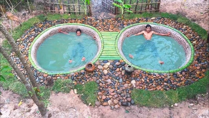Building amazing twin swimming pool from the stone in the deep forest