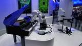 Как роботы играют на пианино