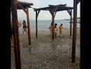 В Новороссийске на городском пляже купающихся сегодня дождь застал врасплох. Все прятались кто-где мог.Прыгали с мостика. Получ