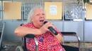 Бабушка поет песню А колокольчики бубенчики звенят