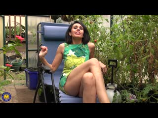 Naughty mom playing with her big pussy lips and a vibrator in her garden house - http://www.vidz72.com