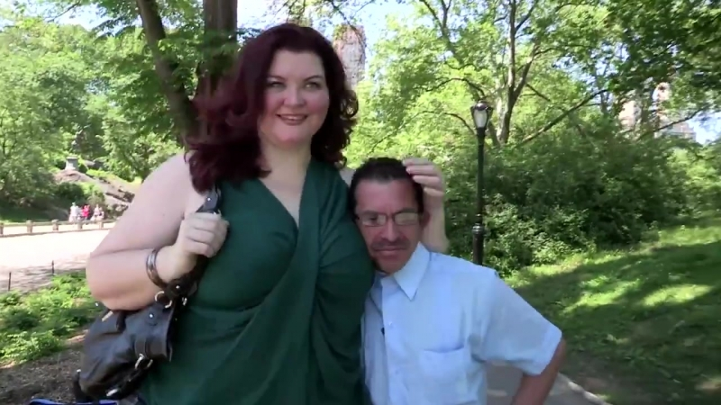Giant Amazon Model Dwarfs Men For A Living