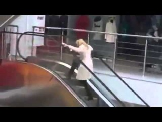 Funny epic fail 2012 Stupid Blonde girl fights with a escalator funny accident 2...