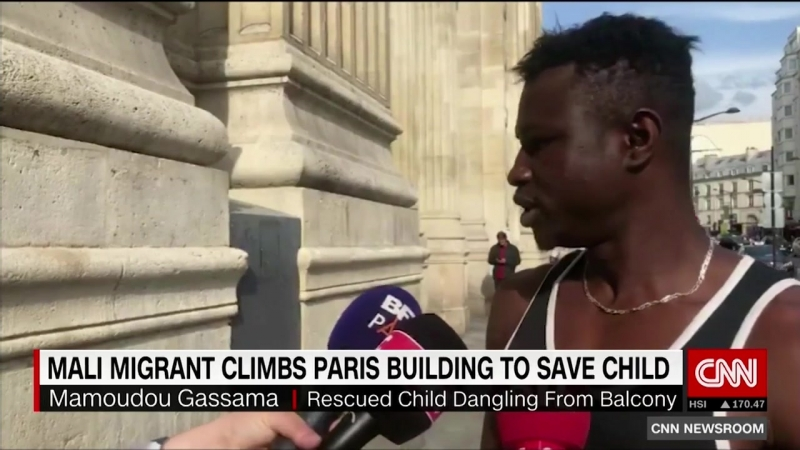 'Spiderman' rescues child dangling from Paris balcony