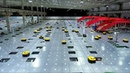 Watch an army of robots efficiently sorting hundreds of parcels per hour