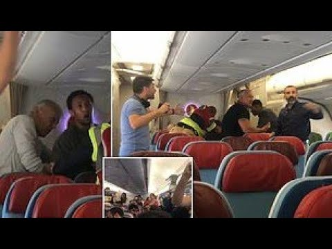 Passengers Help Man Getting Off A Plane As He Resists Deportation