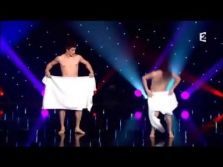 Watch brave French duo perform elaborate nearly NAKED towel dance live on television
