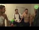 Shirtless amateur soccer players in the locker room