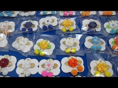 Frutinhas de pompom com mini florzinha no bico de pato