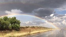 SUPERCELL with textbook hail shaft, amazing double rainbow