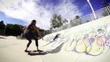 Surfer Skater Girl Sabina on her Surf Skate SmoothStar