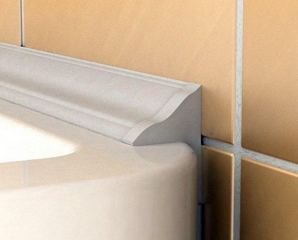 Как заделать шов между ванной и стеной
