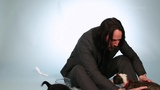 Keanu Reeves Plays With Puppies