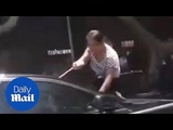 Furious wife jumps onto bonnet of unfaithful hubby's car - Daily Mail