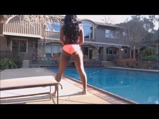 Hot ebony girl dancing pool side in bikini