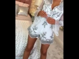 Stand out from the crowd in this white and silver sparkle playsuit