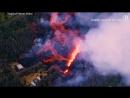 Аэрофотосъемка извержения вулкана Килауэа – лава уничтожает город
