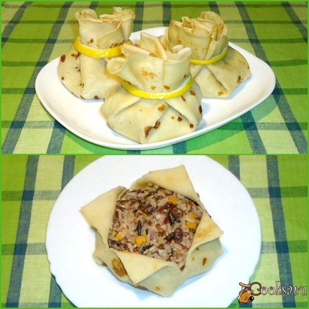 Вкусные блины,фаршированные рисом,тыквой,изюмом и орехами,оформленные в виде мешочков.