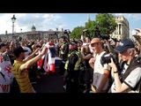 Tommy Robinson Supporters Chant At Police And