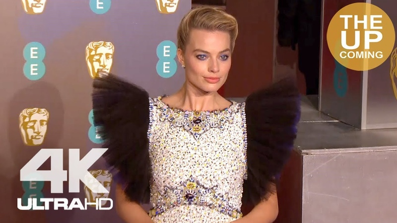 Margot Robbie at BAFTAs Arrival red carpet photocall for Mary Queen of Scots
