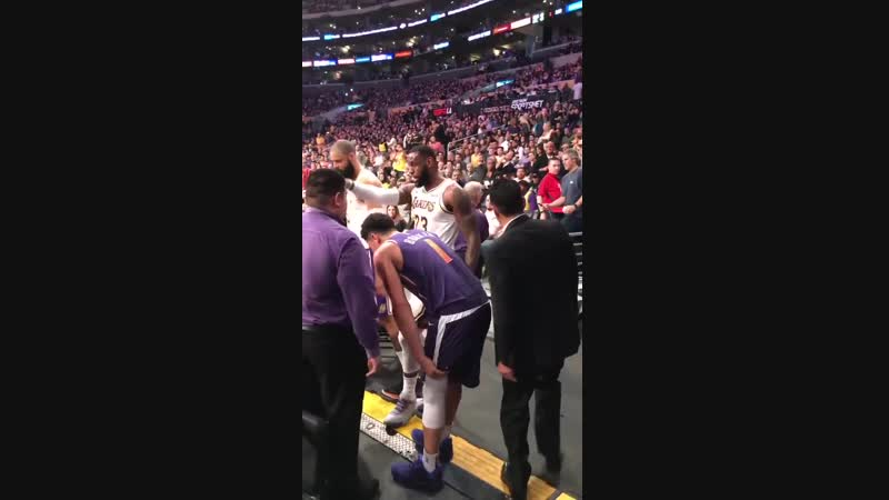 Devin Booker walling over to the locker room after injuring himself chasing a loose ball