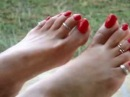 PRETTY FEET BARE WITH TOE RINGS AND BEAUTIFUL LONG RED TOENAILS
