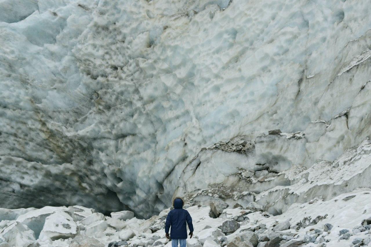 man and glacier