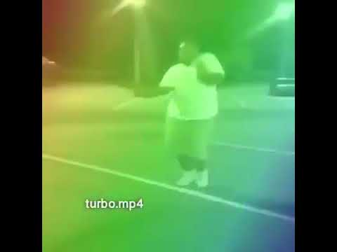 Black fat guy smashing a watermelon with sweet anime song