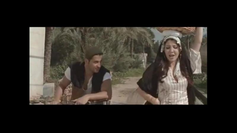 Ненси Ачрам - Ах ваНнус   Nancy Ajram - Ah W Noss (Official Clip) ⁄ نانسي عجرم - فيديو كليب اه و نص
