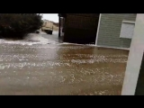 Surf flows between two homes on Ocean View Drive in Avon