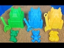 Play with big sand molds and toy shovels on outdoor playground