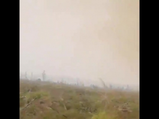 Firefighters get their hose sucked into a 200 ft. tall fire tornado
