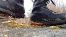 Army boots crush orange