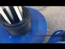 Размотчик на заправке кабеля в гофру