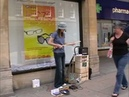Bemuzic goes busking armed with a 3 string Cigar Box Guitar Diddley Bow Canjo and Loop pedal