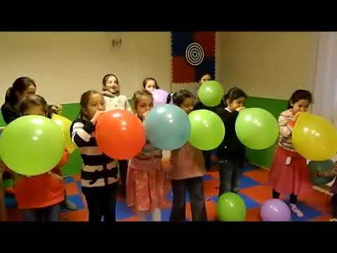 Girls blow up balloons
