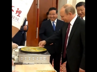 Президент готовит блюда китайской кухни