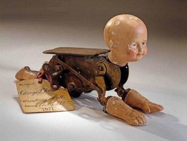 Старинная механическая кукла «Ползающий ребёнок» конца 19 века