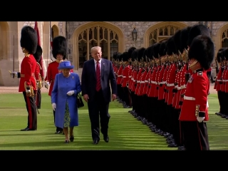Queen ushers Donald Trump along as he inspects Guards