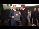 Heres the moment Prince William is handed a tiny NUFC shirt for his son George.mp4