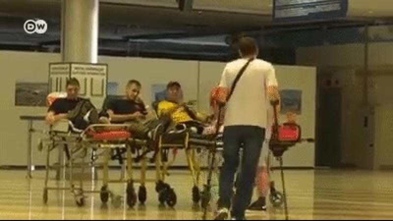 Сюжет DW. Нацистское приветствие раненых карателей из Украины в Германии