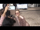 Josephine Skriver arrives at Matinez Hotel in Cannes and pose with fans