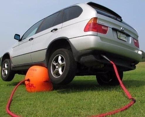 Подушка которая подкладывается под днище автомобиля и накачивается от выхлопной трубы тем самым поднимая автомобиль
