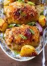 Куриные бедрышки с картофелем